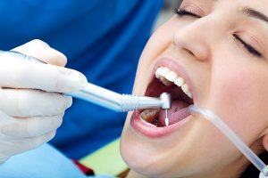 Medical scene of cute young woman at the dentist.